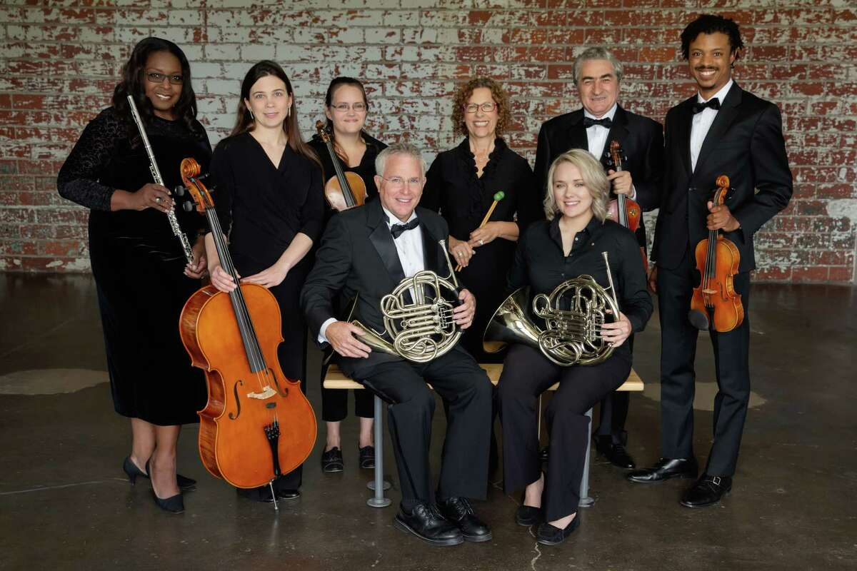 """Fort Bend Symphony Orchestra concludes its 25th season with """"Carmina Burana"""" on May 21 in Stafford. Musicians include, from left, front: Dan Patterson and Elyssa Munden; back: Stacey Tharalson, Katherine Leskin, Patricia Kelley, Andrea Cope, Tofik Khanmamedov and Jordon Nickerson."""