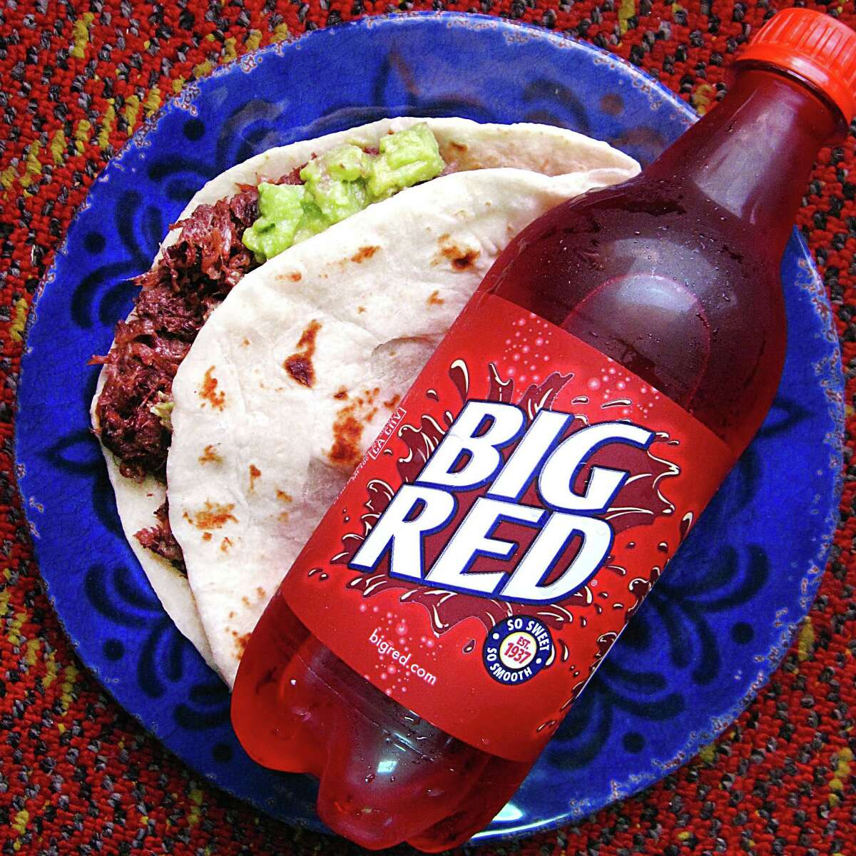 Big Red and barbacoa special - a barbacoa taco with guacamole on a handmade flour tortilla with a 20-ounce Big Red - from Tommy's Restaurant.