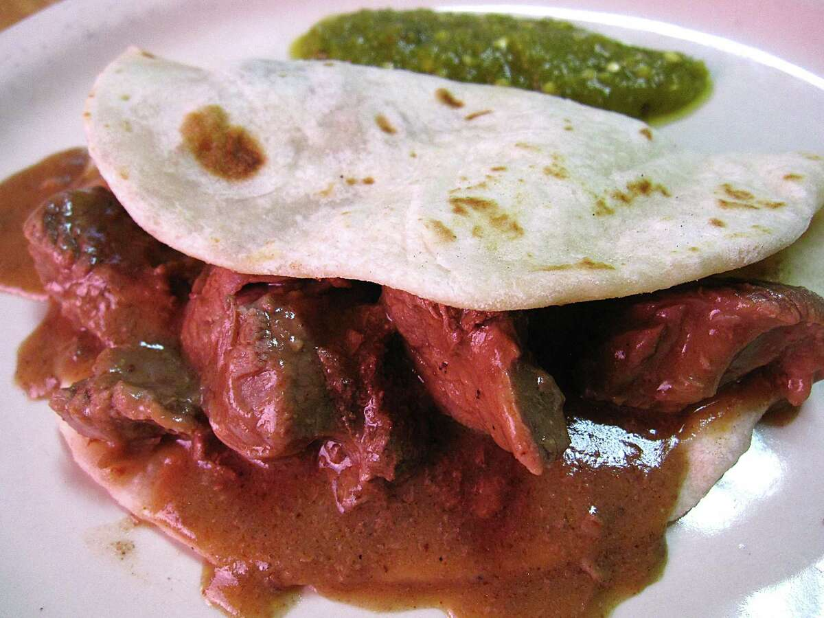 Carne guisada taco on a handmade flour tortilla from Tommy's Restaurant. The new restaurant at 13271 Silicon Drive, near the intersection of I-10 and DeZavala Road, opened its doors Saturday serving tacos, nachos and other Tex-Mex plates for breakfast and lunch.