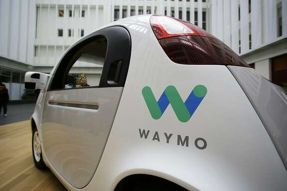 FILE - In this Tuesday, Dec. 13, 2016, file photo, the Waymo driverless car is displayed during a Google event, in San Francisco. Waymo, the self-driving car company owned by Google's parent Alphabet Inc., and Lyft Inc. are teaming up to road test autonomous cars in a potential challenge to Uber Technologies Inc. (AP Photo/Eric Risberg, File)
