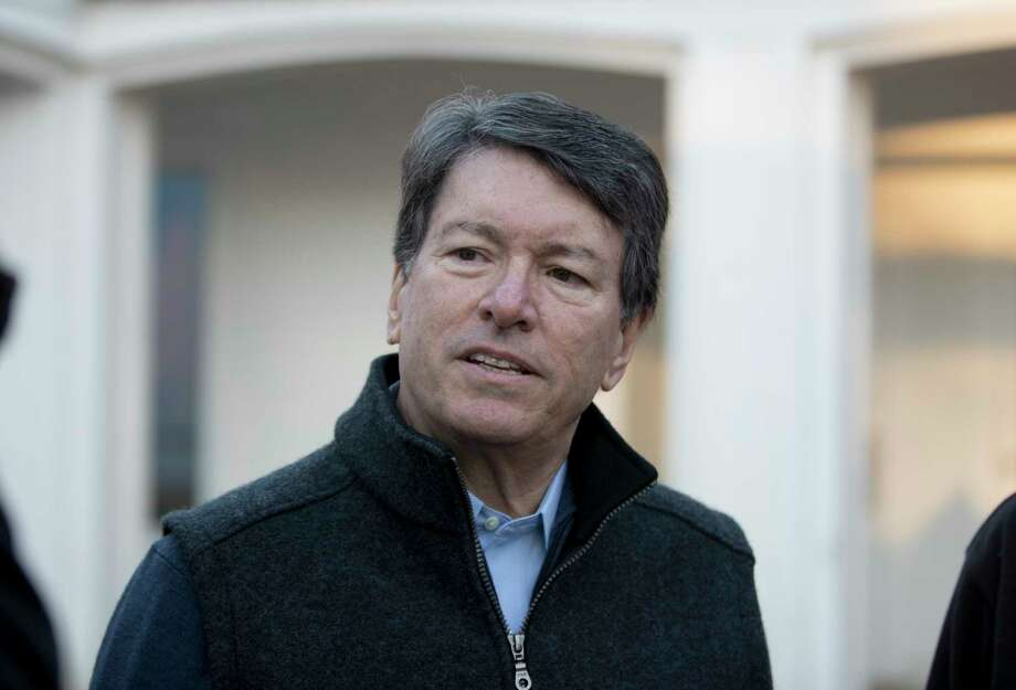 In this photo taken Nov. 8, 2016, then-New York's 19th Congressional District Republican candidate, now-Rep. John Faso, R-N.Y., talks with media members after voting in Kinderhook, N.Y. On the job little more than four months, Faso is facing a political firestorm in his own backyard that threatens to consume his first term in Congress just as it begins.  (AP Photo/Mike Groll, File) ORG XMIT: WX102 Photo: Mike Groll / Copyright 2016 The Associated Press. All rights reserved.