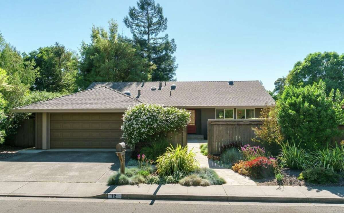 Tucked away on a quiet cul-de-sac next to the oak-studded Mount Burdell Open Space, 12 Woodleaf Ct. in Novato puts you in a park-like setting. The three-bedroom, two-bath is listed for $995,000.