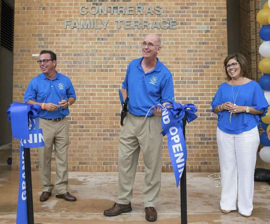 Tom Contreras (from left), St. Mary's president Thomas Mengler, and Leti Contreras at a ribbon cutting that reopened The Pub at St. Mary's University in 2015. On Monday, the university announced the couple had donated $2 million to bolster the teaching of risk management at its business school. (Darren Abate/For the Express-News) Photo: Darren Abate /Darren Abate /Express-News