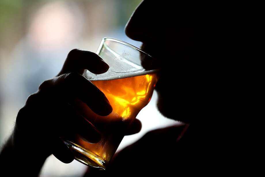 SANTA ROSA, CA - FEBRUARY 07:  A Russian River Brewing Company customer takes a sip of the newly released Pliny the Younger triple IPA beer on February 7, 2014 in Santa Rosa, California. Photo: Justin Sullivan, Getty Images