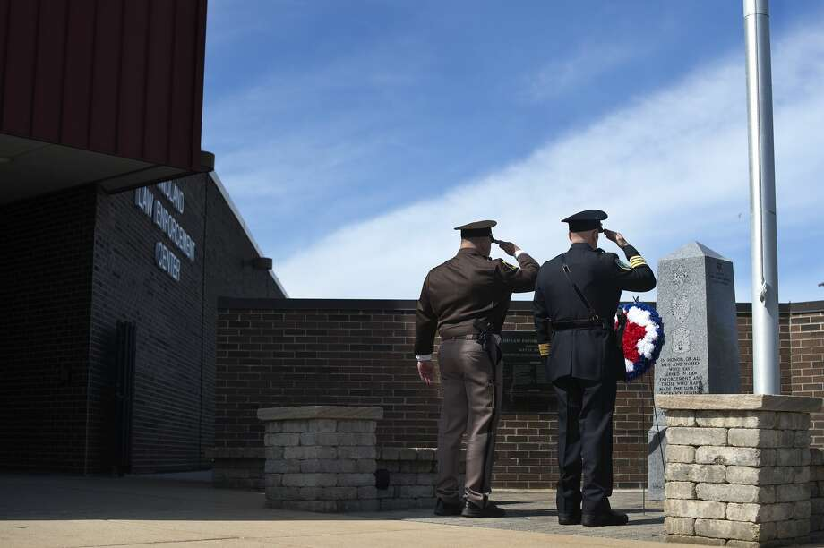 Midland County Sheriff Scott Stephenson, left, and Midland Chief of Police Clifford Block salute a wreath laid during a ceremony honoring National Peace Officers Memorial Day on Monday at the Law Enforcement Center. Photo: Brittney Lohmiller/Midland Daily News/Brittney Lohmiller