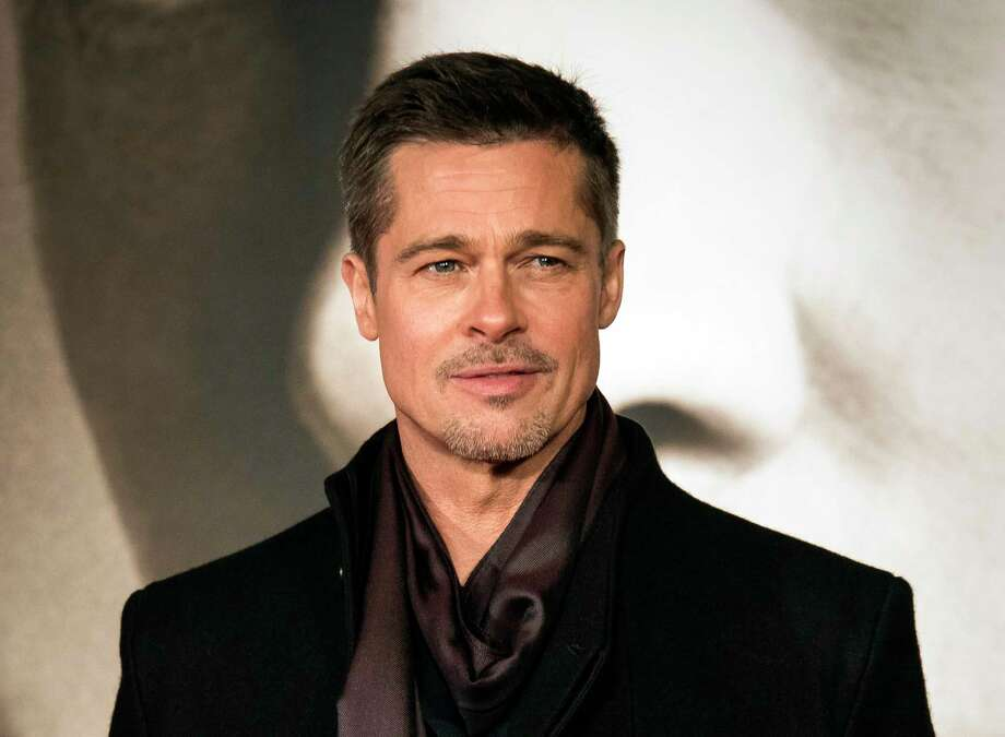 """Brad Pitt appears at the 2016 premiere of """"Allied"""" in London. At 55, Pitt now says he's reached a point where he sees his father in every performance he gives. """"I grew up with that be-capable, be-strong, don't-show-weakness thing,"""" Pitt said. """"In some ways, I'm copying him."""" Photo: Vianney Le Caer, INV / Invision"""