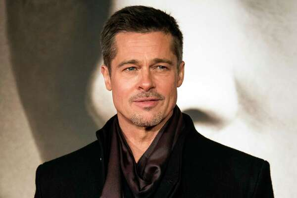 "FILE - In this Nov. 21, 2016 file photo, Brad Pitt appears at the premiere of ""Allied"" in London. Pitt says there needs to be a rethinking of what winning the war in Afghanistan means and sending more American troops there will only cause more damage. The Oscar-nominated actor also said that the public should reassess how it supports soldiers and needs to do more than just give money to causes and give veterans a pat on the back. PittÂ?'s comments came in an interview last week in which the actor was discussing his life, and his upcoming Netflix film Â?""War Machine.Â?"" (Photo by Vianney Le Caer/Invision/AP, File)"