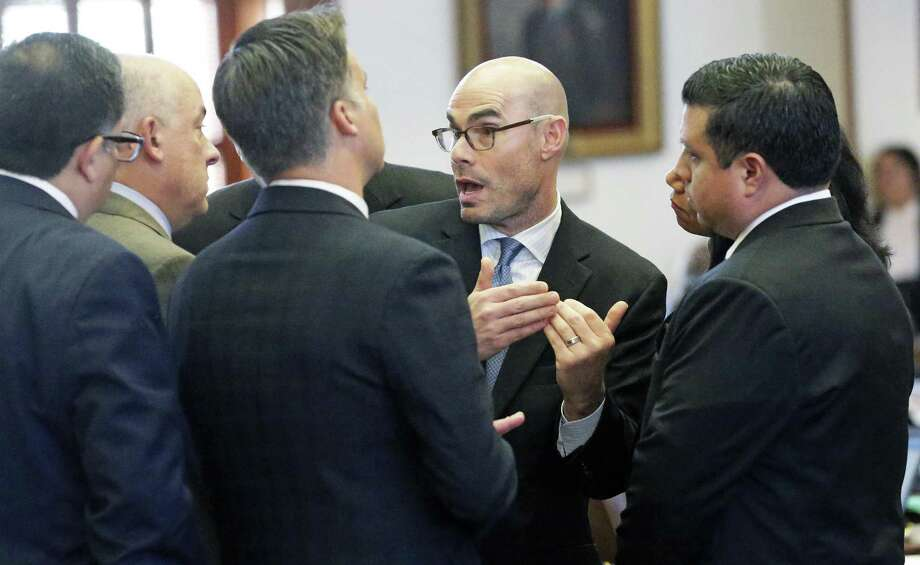"""House Ways and Means Committee Chairman Dennis Bonnen says, """"The cities and counties refuse to accept any version of Senate Bill 2, so I look forward to working with the governor and the lieutenant governor to shove it down their throat in a special session."""" Bonnen (center) is shown speaking with a group of legislators during a debate in April. Photo: Tom Reel /San Antonio Express-News / 2017 SAN ANTONIO EXPRESS-NEWS"""