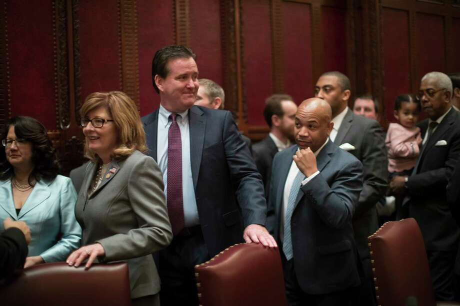 FILE -- New York Republican State Senator Pamela Helming, left, in the New York State Senate chamber at the state Capitol, in Albany, N.Y., Jan. 4, 2017. Helming and two other Republican state senators were falsely identified in March as the leaders of Senate committees in documents sent to the state comptroller by Senate payroll staff, resulting in the lawmakers receiving thousands of dollars in stipends meant for others. (Nathaniel Brooks/The New York Times) ORG XMIT: XNYT135 Photo: NATHANIEL BROOKS / NYTNS