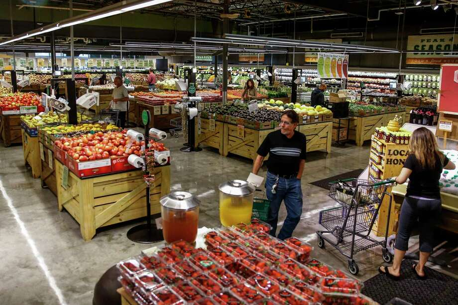 Shoppers in the produce section at Central Market, which recently completed a $10 million renovation that expanded the store's produce section by about 3,000 square feet. Photo: Michael Ciaglo, Staff / Michael Ciaglo