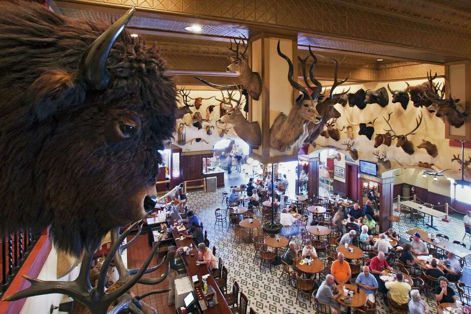 Buffalo heads and countless other animal trophies decorate the walls and bar area of the Buckhorn Saloon and Museum. Photo: Al Rendon / Courtesy Of Buckhorn Saloon & Museum