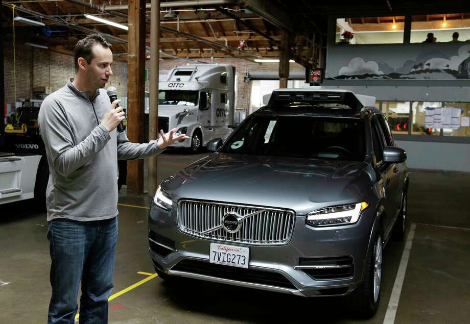 FILE- In this Dec. 13, 2016, file photo, Anthony Levandowski, head of Uber's self-driving program, speaks about their driverless car in San Francisco. In an order filed Monday, May 15, 2017, a federal judge ordered Uber to stop using technology that Levandowski downloaded before he left Waymo, the Alphabet Inc. autonomous car arm that was spun off from Google. The order filed Monday in a trade secrets theft lawsuit also forces Uber to return all downloaded materials. (AP Photo/Eric Risberg, File) ORG XMIT: NYBZ110 Photo: Eric Risberg / Copyright 2016 The Associated Press. All rights reserved.
