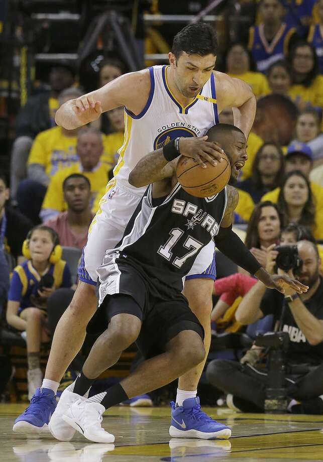 San Antonio Spurs guard Jonathon Simmons (17) is fouled by Golden State Warriors center Zaza Pachulia, top, during the first half of Game 1 of the NBA basketball Western Conference finals in Oakland, Calif., Sunday, May 14, 2017. (AP Photo/Jeff Chiu) Photo: Jeff Chiu, Associated Press