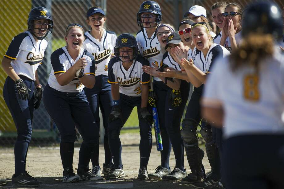 The Midland High softball team cheers on Maya Kipfmiller as she rounds third base after hitting a home run in a game against Coleman at Midland High School on Monday. Photo: Theophil Syslo