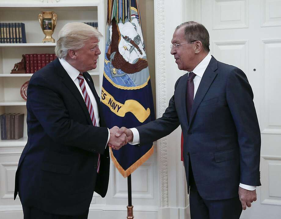 Trump shaking hands with Russian Foreign Minister Sergei Lavrov Photo: HO, AFP/Getty Images