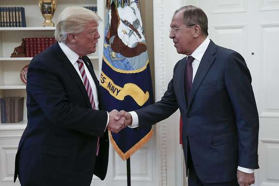 Trump shaking hands with Russian Foreign Minister Sergei Lavrov
