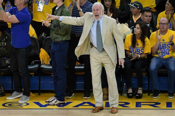 OAKLAND, CA - MAY 14:  Gregg Popovich of the San Antonio Spurs signals to his team during Game One of the NBA Western Conference Finals against the Golden State Warriors at ORACLE Arena on May 14, 2017 in Oakland, California. NOTE TO USER: User expressly acknowledges and agrees that, by downloading and or using this photograph, User is consenting to the terms and conditions of the Getty Images License Agreement.  (Photo by Thearon W. Henderson/Getty Images)