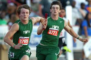 The Woodlands' Jake Lanier, right, hands the baton off to Jacob Barrett in the 6A boys 4x200 meter relay during the UIL State Track & Field Championships, Saturday, May 13, 2017, in Austin.