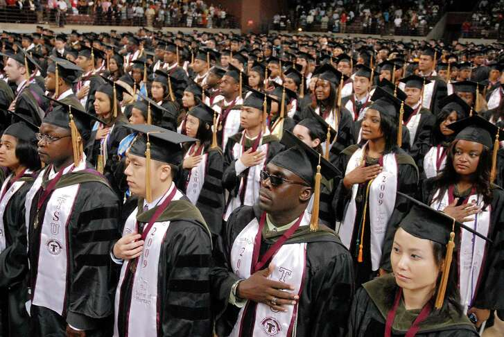 Graduates stand for the National Anthem at the Texas Southern University 2009 commencement. (Chronicle File Photo)