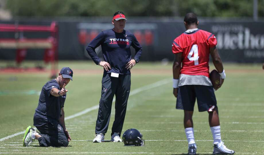Texans Coach Bill O'Brien gives DeShaun Watson feedback as he runs through drills during Texans rookie camp at NRG practice field   Saturday, May 13, 2017, in Houston. ( Steve Gonzales  / Houston Chronicle ) Photo: Steve Gonzales, Staff / © 2017 Houston Chronicle