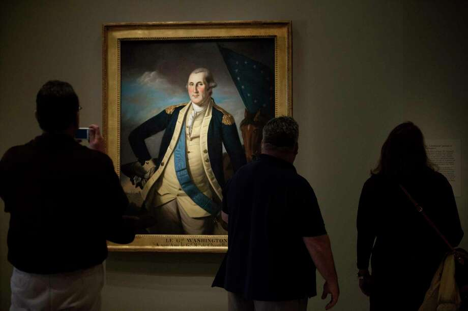 A portrait of George Washington, by Charles Willson Peale, at the National Portrait Gallery in Washington, Dec. 20, 2016. The primacy of our country's institutions over even the greatest of leaders has been a decisive thread in American history, and it's one reason President Donald Trump is so unnerving, writes columnist Nicholas Kristof. (Tyrone Turner/The New York Times) Photo: TYRONE TURNER, STR / NYTNS