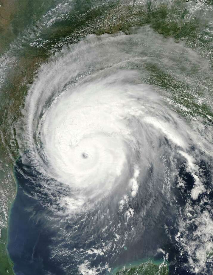 This satellite image from NASA taken on September 23, 2005 shows Hurricane Rita as it started making landfall. Rita was a Category Three Hurricane when it hit the coastline of Texas and Louisiana. (Illustration by NASA via Getty Images) Photo: NASA, Handout / 2005 NASA