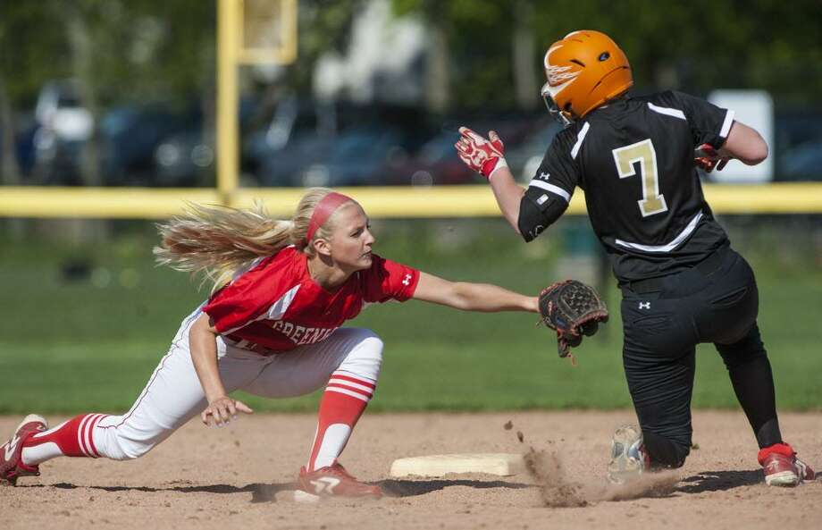 Trumbull high school graduate Harleigh Kaczegowicz, here seen getting tagged out during a 2014 softball game at Greenwich High School, has been named a first-team All-Liberty League selection. Photo: Mark Conrad / Mark Conrad / Connecticut Post Freelance