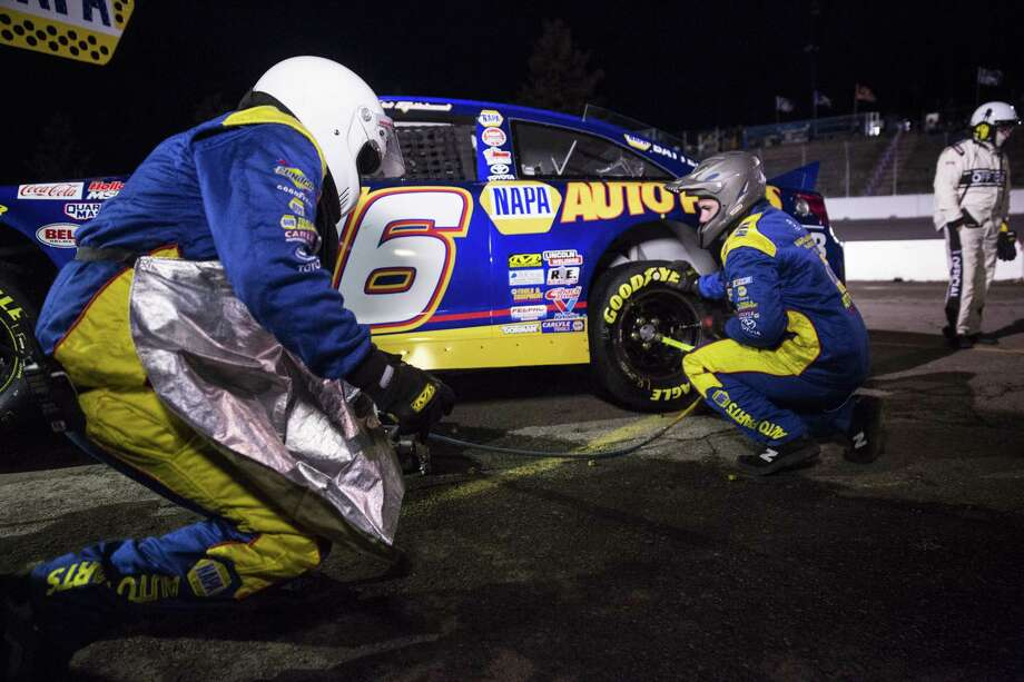 SPOKANE, WA - MAY 13: Members of Todd Gilliland #16 pit crew work to change tires and prepare the vehicle for the second half during the NAPA Auto Parts 150 at Spokane County Raceway on May 13, 2017 in Spokane, Washington. Todd Gilliland finished first, followed by Derek Kraus and Chris Eggleston. (Photo by Lindsey Wasson/Getty Images for NASCAR) ORG XMIT: 700046968 Photo: Lindsey Wasson / 2017 Getty Images