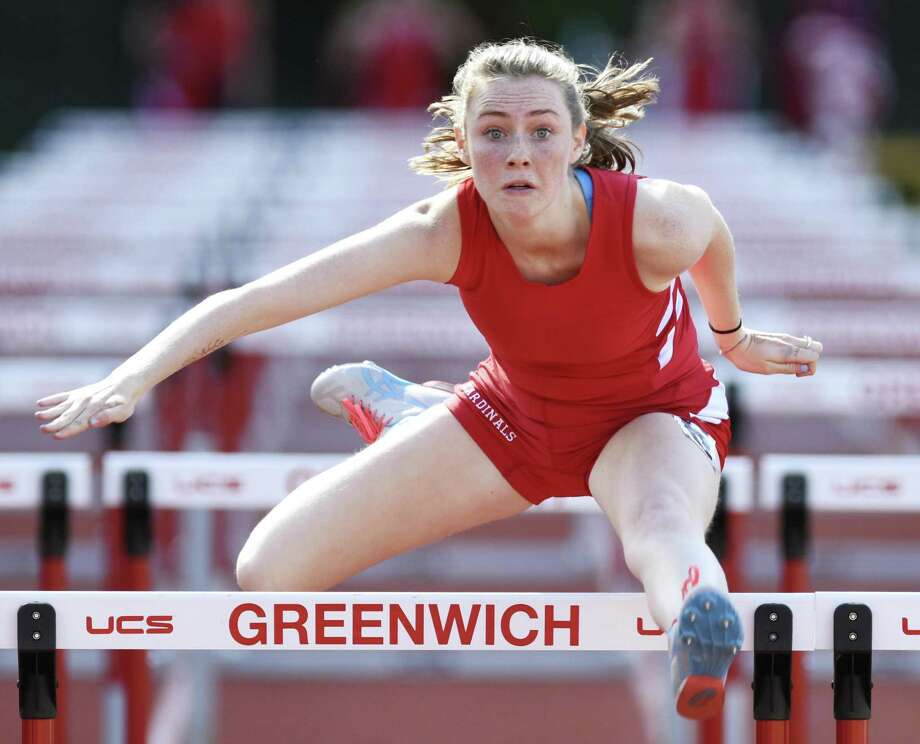 Greenwich sophomore Sinead Clarke competes in the 100-meter hurdles against Staples at Greenwich High School on Monday. Photo: Tyler Sizemore / Hearst Connecticut Media / Greenwich Time