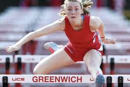 Greenwich sophomore Sinead Clarke competes in the 100-meter hurdles against Staples at Greenwich High School on Monday.