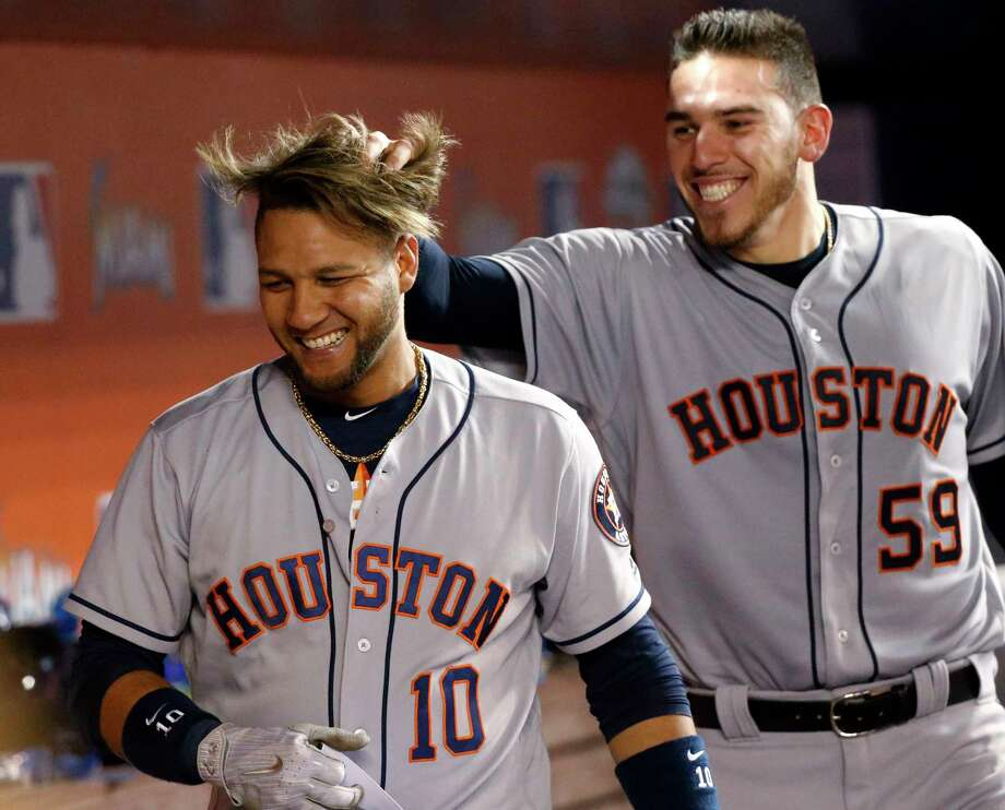 Houston Astros starting pitcher Joe Musgrove (59) messes up the hair of Yuli Gurriel (10) after Gurriel hit a grand slam during the sixth inning of a baseball game against the Miami Marlins, Monday, May 15, 2017, in Miami. Gurriel drove in Evan Gattis, Carlos Correa, and Josh Reddick. (AP Photo/Wilfredo Lee) Photo: Wilfredo Lee, Associated Press / Copyright 2017 The Associated Press. All rights reserved.