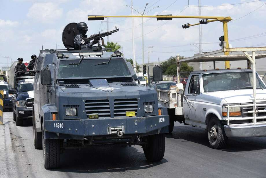 Mexican federal police in an armored truck patrol Reynosa, where drug violence has spilled into the streets nearly daily. Photo: Billy Calzada / San Antonio Express-News / San Antonio Express-News