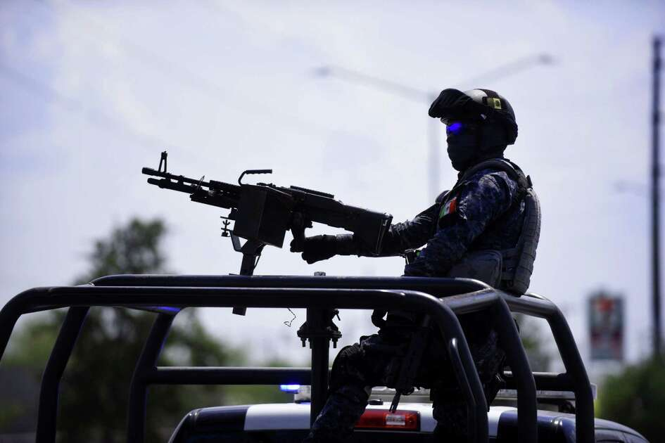 A federal police officer mans a weapon during a patrol in Reynosa, one of the most dangerous cities in Mexico.