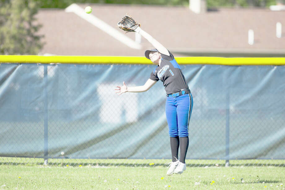 THEOPHIL SYSLO | For the Daily News Coleman's Brianna Townsend attempts to catch a fly ball in a game against Midland at Midland High School on Monday.