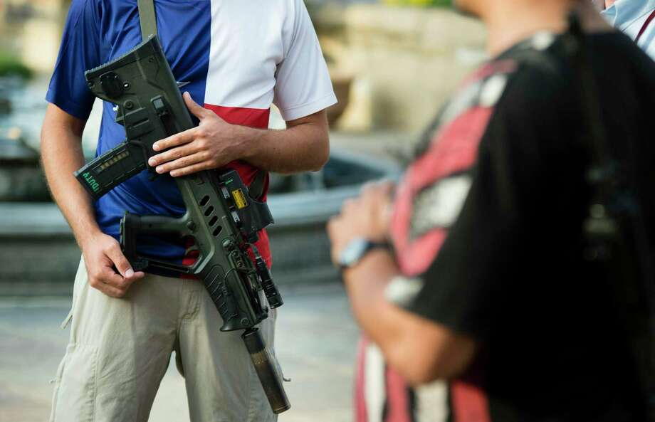 Members of Open Carry Texas meet at the Bexar County Courthouse in 2017. A reader says open carry makes it difficult to discern law-abiding citizens from would-be mass shooters. Photo: File Photo / San Antonio Express-News