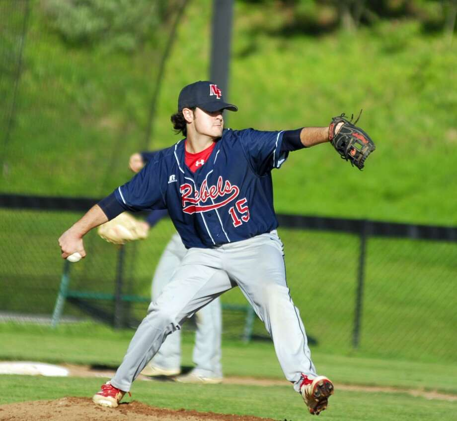 New Fairfield's Sean King throws a pitch during a game against Newtown on Monday. Photo: Ryan Lacey / Hearst Connecticut Media