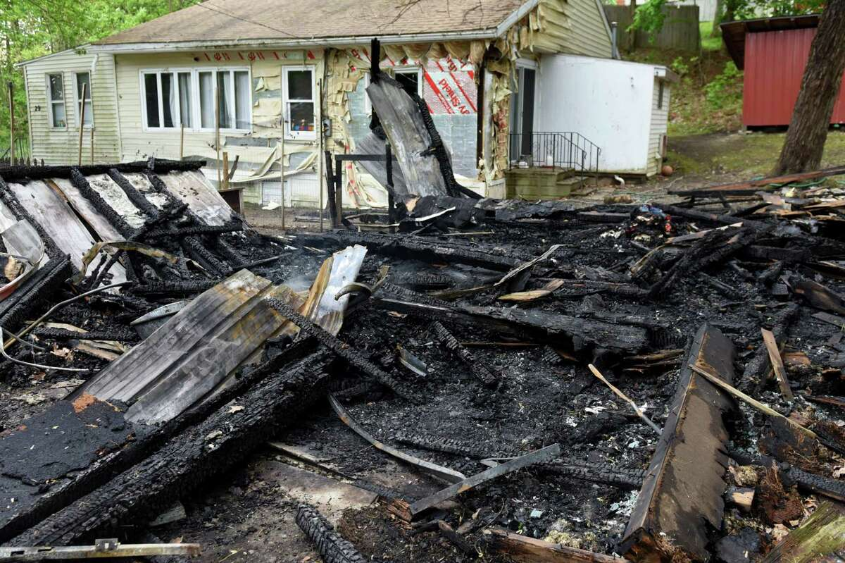 The smoldering remains of a building on Cold Spring Avenue on Monday, May 15, 2017, in Schodack, N.Y. Authorities said someone set fire to the structure on Sunday and the fire is considered a hate crime. Schodack police do not identify the race or religion of the homeowners but a source says the victims are black. (Will Waldron/Times Union)
