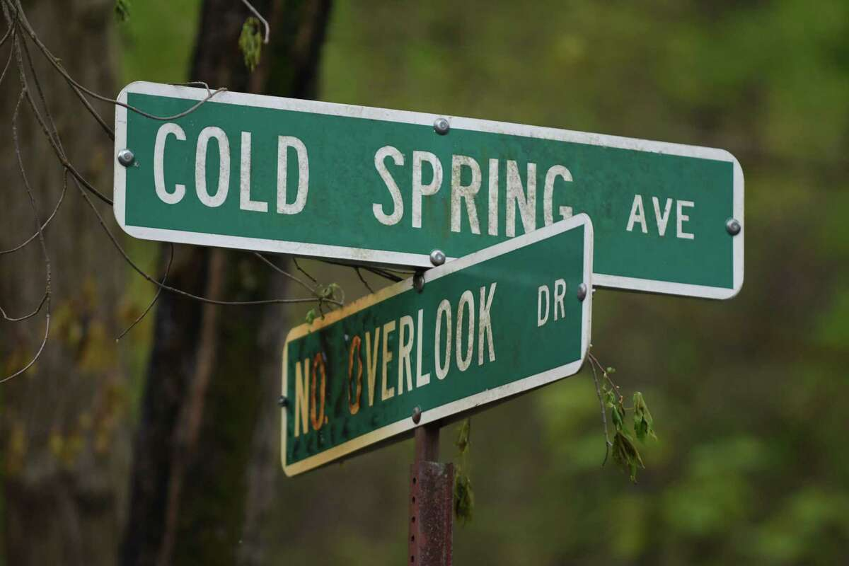 Road sign at Cold Spring Avenue and No Overlook Drive near the scene of a fire on Monday, May 15, 2017, in Schodack, N.Y. Authorities said someone set fire to a building at 29 Cold Spring on Sunday and the fire is considered a hate crime. Schodack police do not identify the race or religion of the homeowners but a source says the victims are black. (Will Waldron/Times Union)