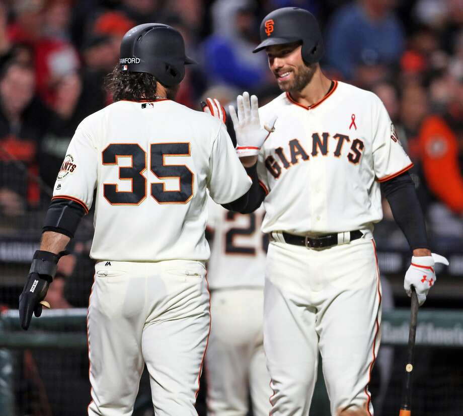 San Francisco Giants' Mac Williamson greets Brandon Crawford after Crawford scored on Eduardo Nunez' infield single against Los Angeles Dodgers in 4th inning during MLB game at AT&T Park in San Francisco, Calif., on Monday, May 15, 2017. Photo: Scott Strazzante / The Chronicle