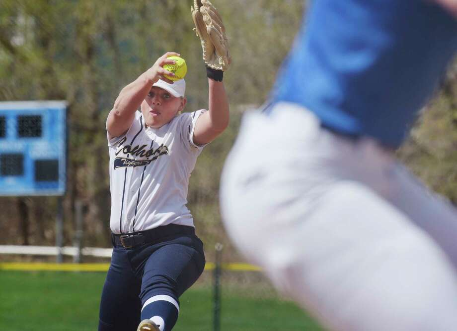 Isabelle DeChiaro of Cohoes delivers a pitch during the Ichabod Crane and Cohoes girls softball game on Monday, April 17, 2017, in Cohoes, N.Y.  (Paul Buckowski / Times Union) / Cohoes
