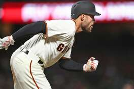 San Francisco Giants' Mac Williamson watches his RBI single in 6th inning against Los Angeles Dodgers during MLB game at AT&T Park in San Francisco, Calif., on Monday, May 15, 2017.