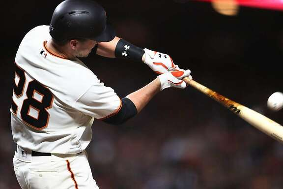 San Francisco Giants' Buster Posey hits a solo home run in 7th inning against Los Angeles Dodgers during MLB game at AT&T Park in San Francisco, Calif., on Monday, May 15, 2017.