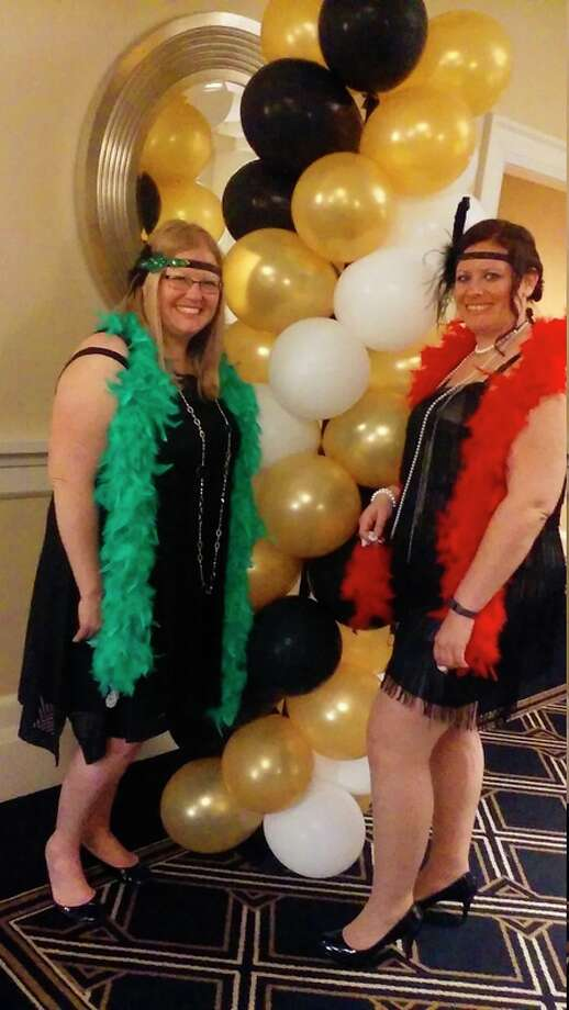 Sarah Hubble, left and Kristin Emerson attend Feathers & Fedoras Friday at the Midland Country Club with a group of eight other friends. The Disability Network of Mid-Michigan drew first-time attendees such as Hubble and repeat attendee Emerson.