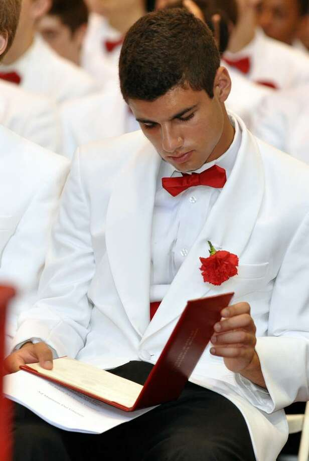 Sofian Ahtichi-Ali looks at his diploma during Fairfield College Preparatory School's 68th Commencement ceremony on Sunday, June 6, 2010. Photo: Amy Mortensen / Connecticut Post Freelance