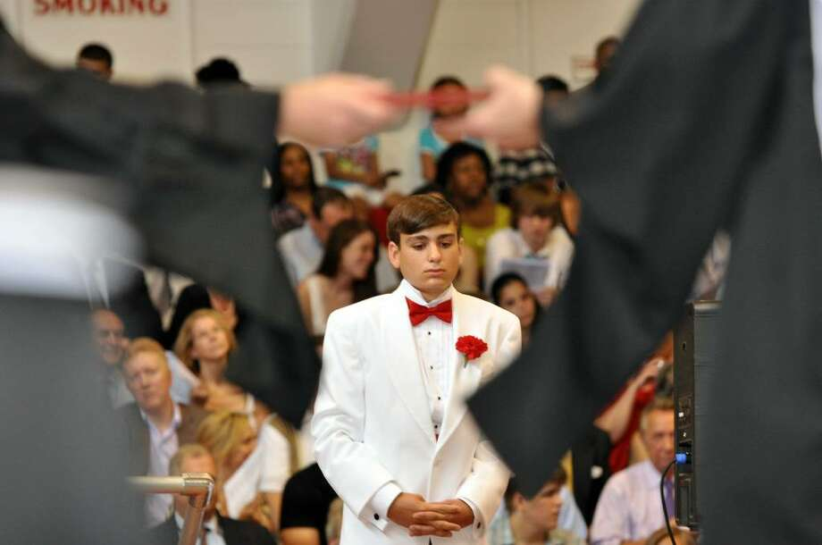 Max Guerrera-Sapone, of Southport, walks forward as his name is called to receive his diploma during Fairfield College Preparatory School's 68th Commencement ceremony on Sunday, June 6, 2010. Photo: Amy Mortensen / Connecticut Post Freelance