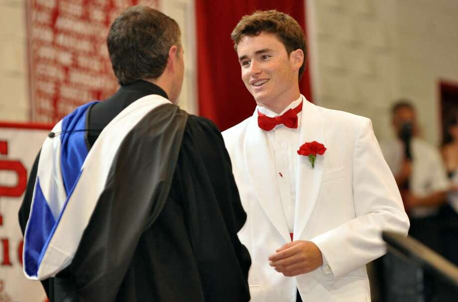 Alexander Oberlander receives his diploma during Fairfield College Preparatory School's 68th Commencement ceremony on Sunday, June 6, 2010. Photo: Amy Mortensen / Connecticut Post Freelance