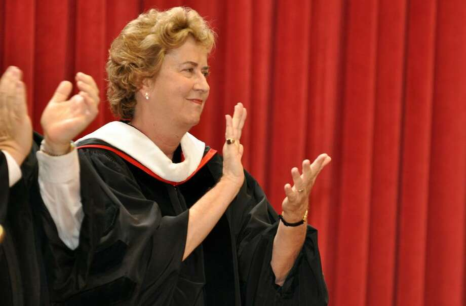 Sister Joan Magnetti, RSCJ, Executive Director Diocese of Bridgeport, Inner City Bridgeport Schools, claps during Fairfield College Preparatory School's 68th Commencement ceremony on Sunday, June 6, 2010. Photo: Amy Mortensen / Connecticut Post Freelance