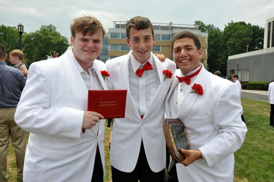 Frank Lupariello, of Shelton; Tyler Capasso, of Monroe and Josh Jowdy, of Newtown, pose for a photo following Fairfield College Preparatory School's 68th Commencement ceremony on Sunday, June 6, 2010. Jowdy, far right, was the recipient of the St. Francis Xavier, S.J. Award. Photo: Amy Mortensen / Connecticut Post Freelance