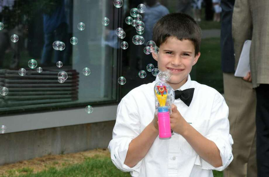 Samuel DeSilva, 9, of Fairfield, blows bubbles in celebration of his brother Ryan's graduation following Fairfield College Preparatory School's 68th Commencement ceremony on Sunday, June 6, 2010. Photo: Amy Mortensen / Connecticut Post Freelance