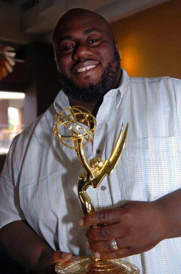 "Greenwich native Justin Joseph holds his first Emmy, which he won as a producer for HBO on the ""24/7 Jimmie Johnson: Race to Daytona"" trailer, at a celebration party at Saltwater Grille in Stamford, on Sunday, June 6, 2010. Joseph lives in Yonkers, N.Y. Photo: Helen Neafsey / Greenwich Time"